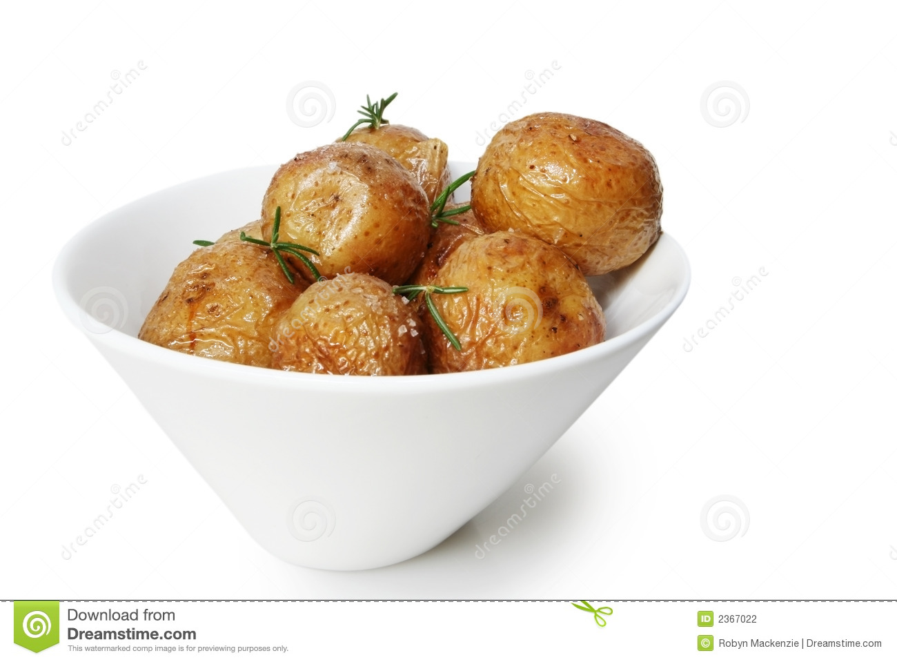 Salt roasted baby potatoes with rosemary, in a white bowl.