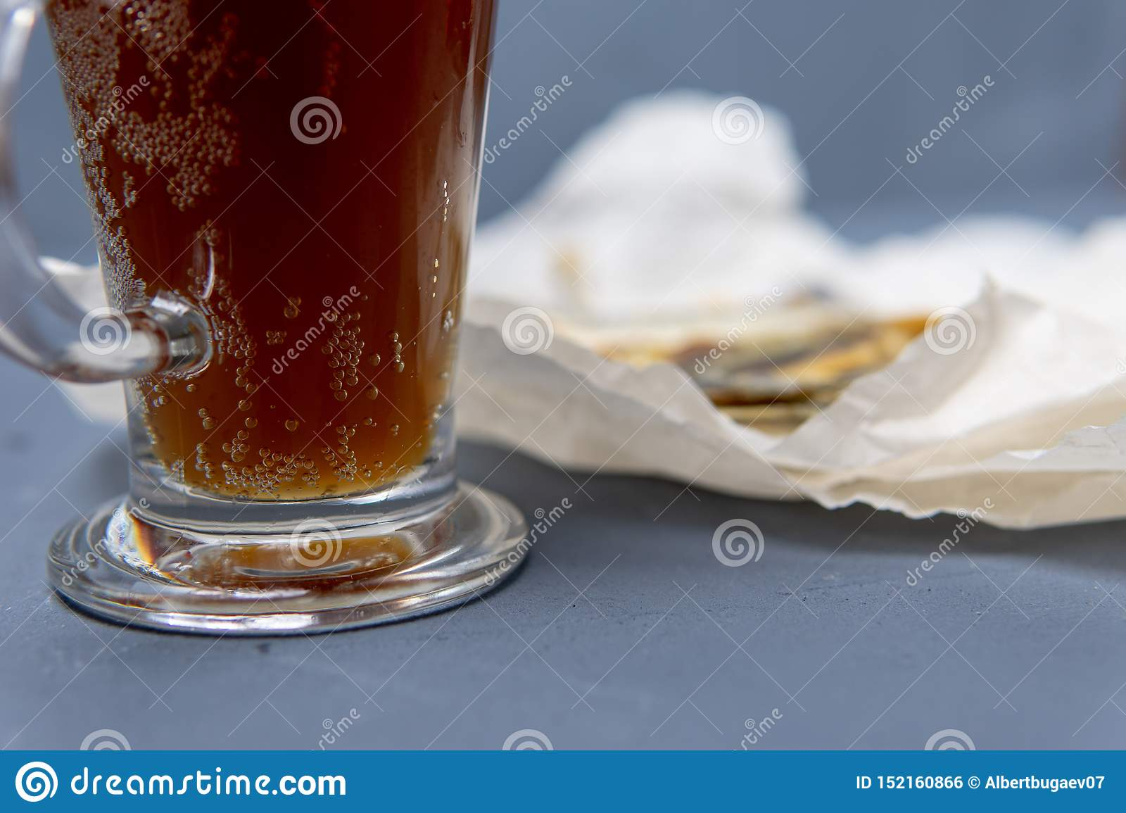 Salted fish lies in unfolded paper