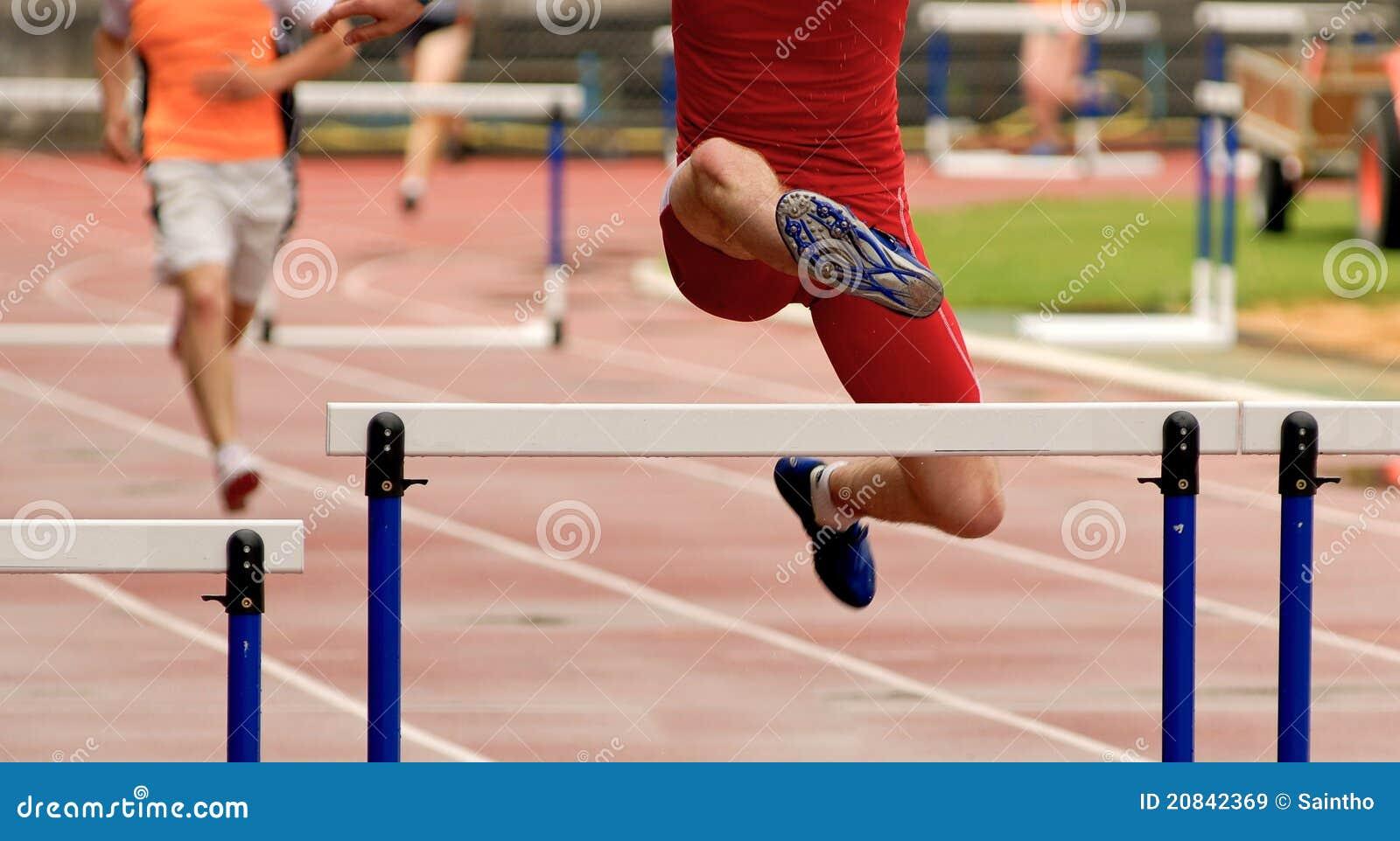 Salto en la carrera de vallas imagen de archivo imagen - Imagen de vallas ...