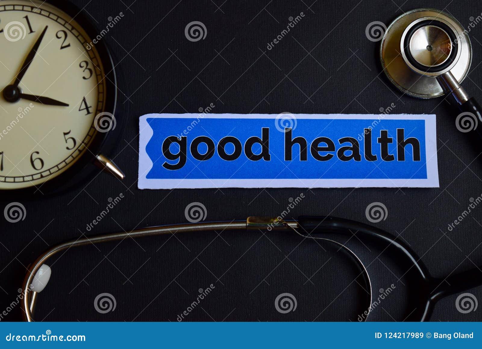 Salud en el papel de la impresión con la inspiración del concepto de la atención sanitaria despertador, estetoscopio negro Buena