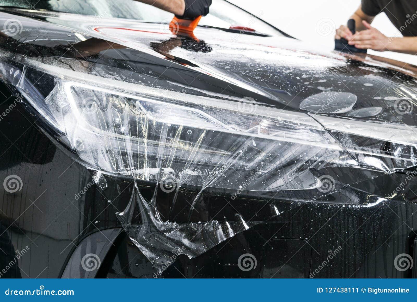 Samochodowa opakunkowa specjalisty kładzenia winylu folia lub film na samochodzie Ochronny film na samochodzie Stosować ochronneg