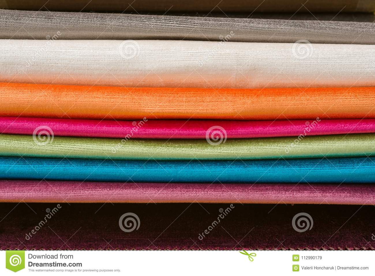 Samples of colorful interior fabrics. Book of fabrics for curtains, upholstery