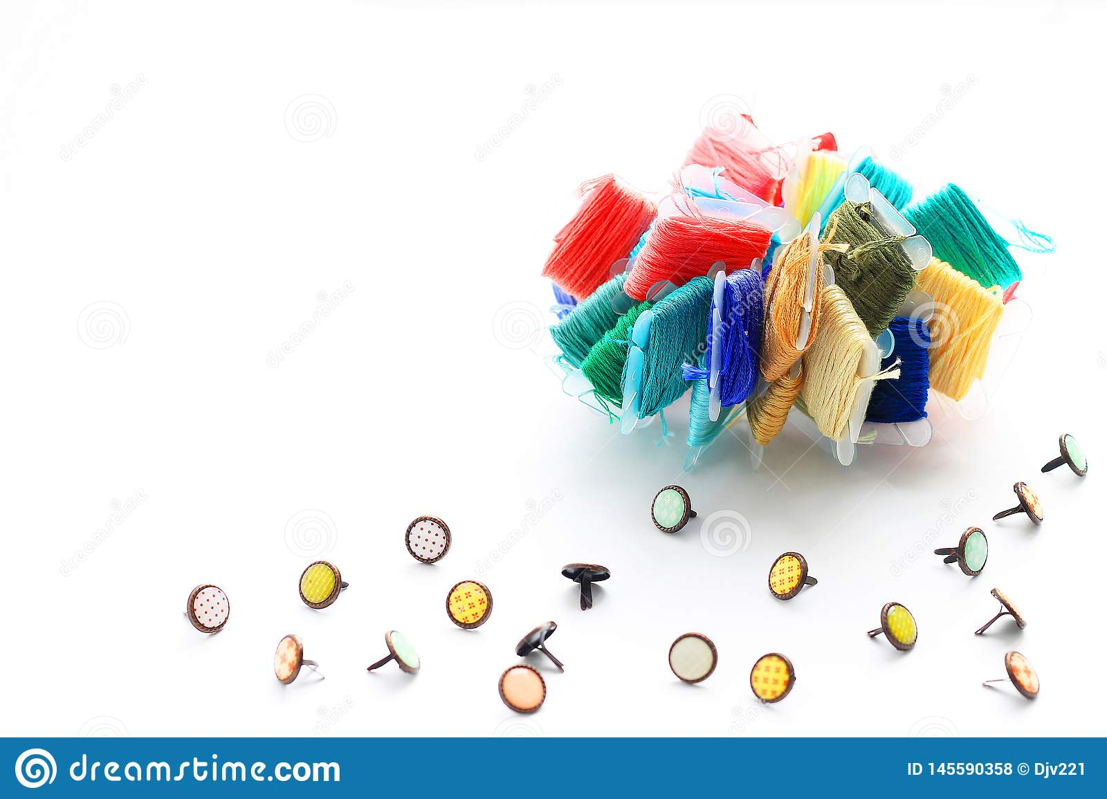 Samples of embroidery threads and buttons for clothes