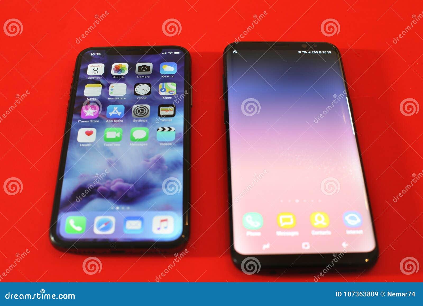 1fccc54c88 BELGRADO, SÉRVIA - 8 DE JANEIRO DE 2018: Os Smartphones os mais novos  Iphone X e a galáxia S8 de Samsung mais como uma comparação do dispositivo,