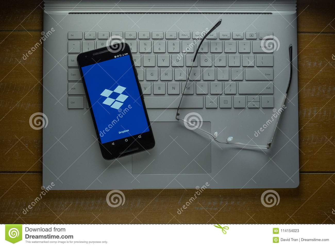 Dropbox app loading on Android phone in a dark room