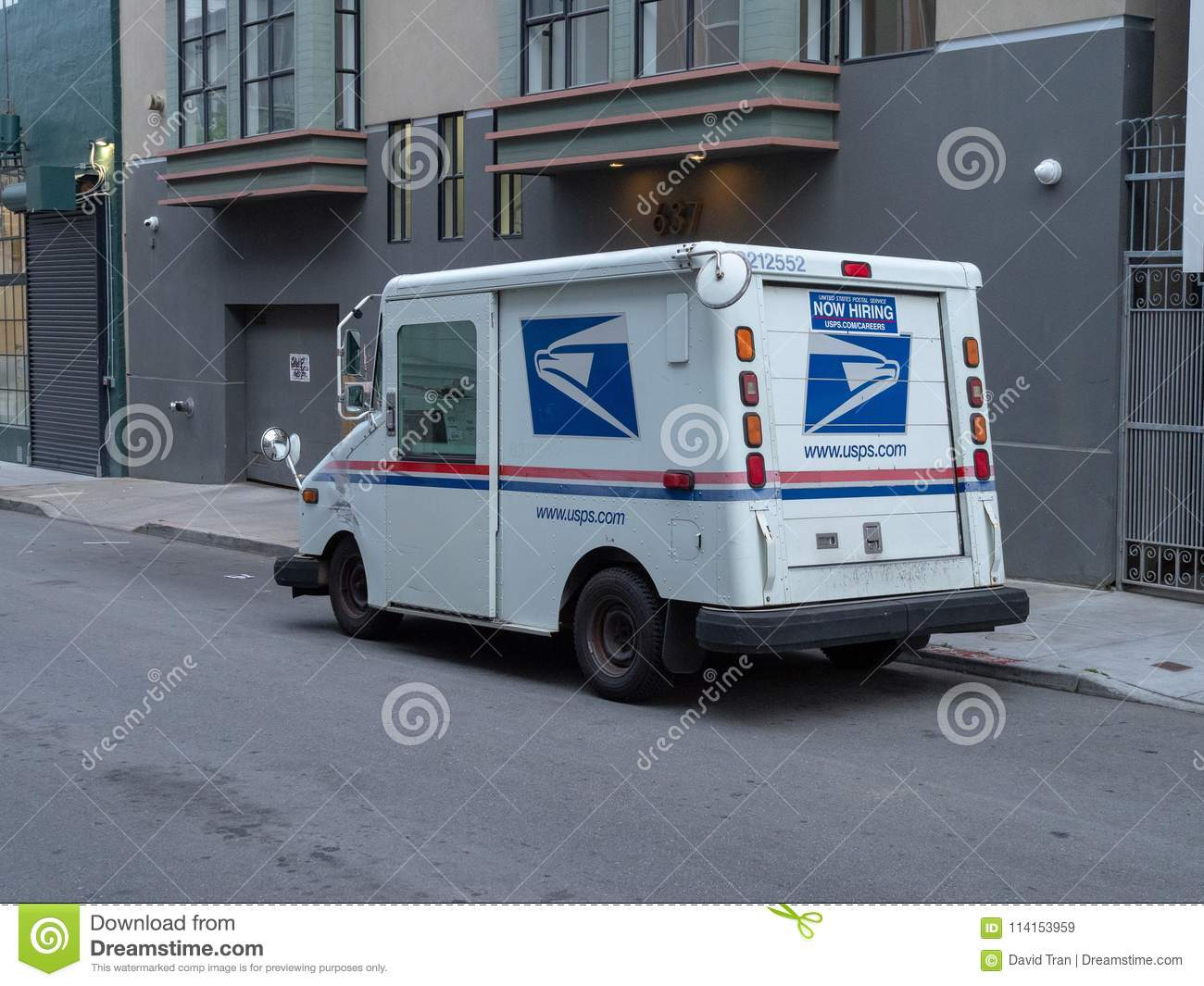 United States Postal Service delivery truck in the city