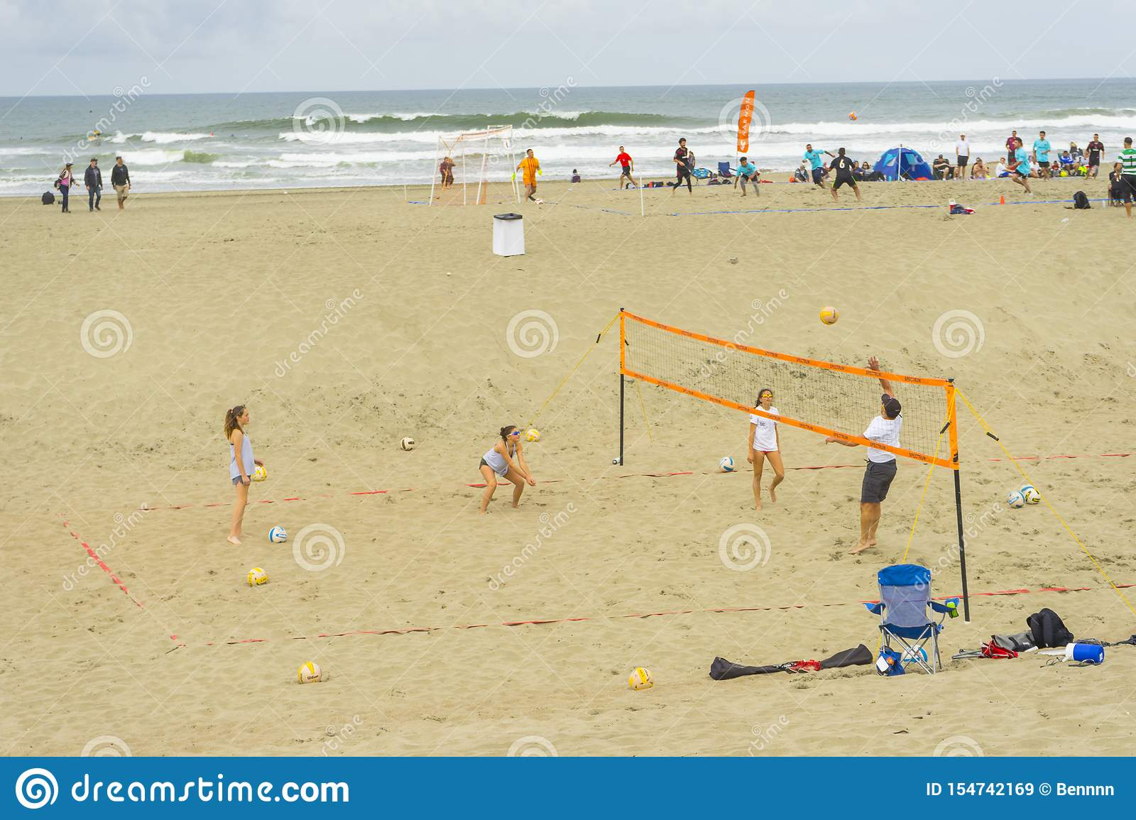 Unidentified People Playing Beach Volleyball At The Ocean ...