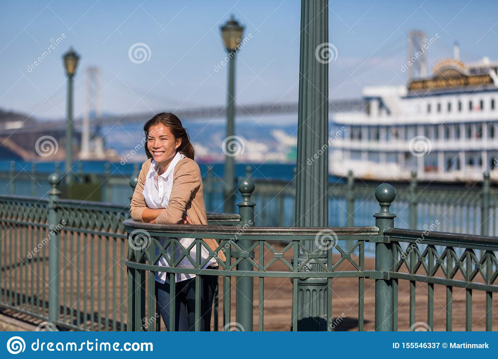 San Francisco cruise vacation travel girl tourist on pier of port. Asian woman looking at view of harbor on marina of San