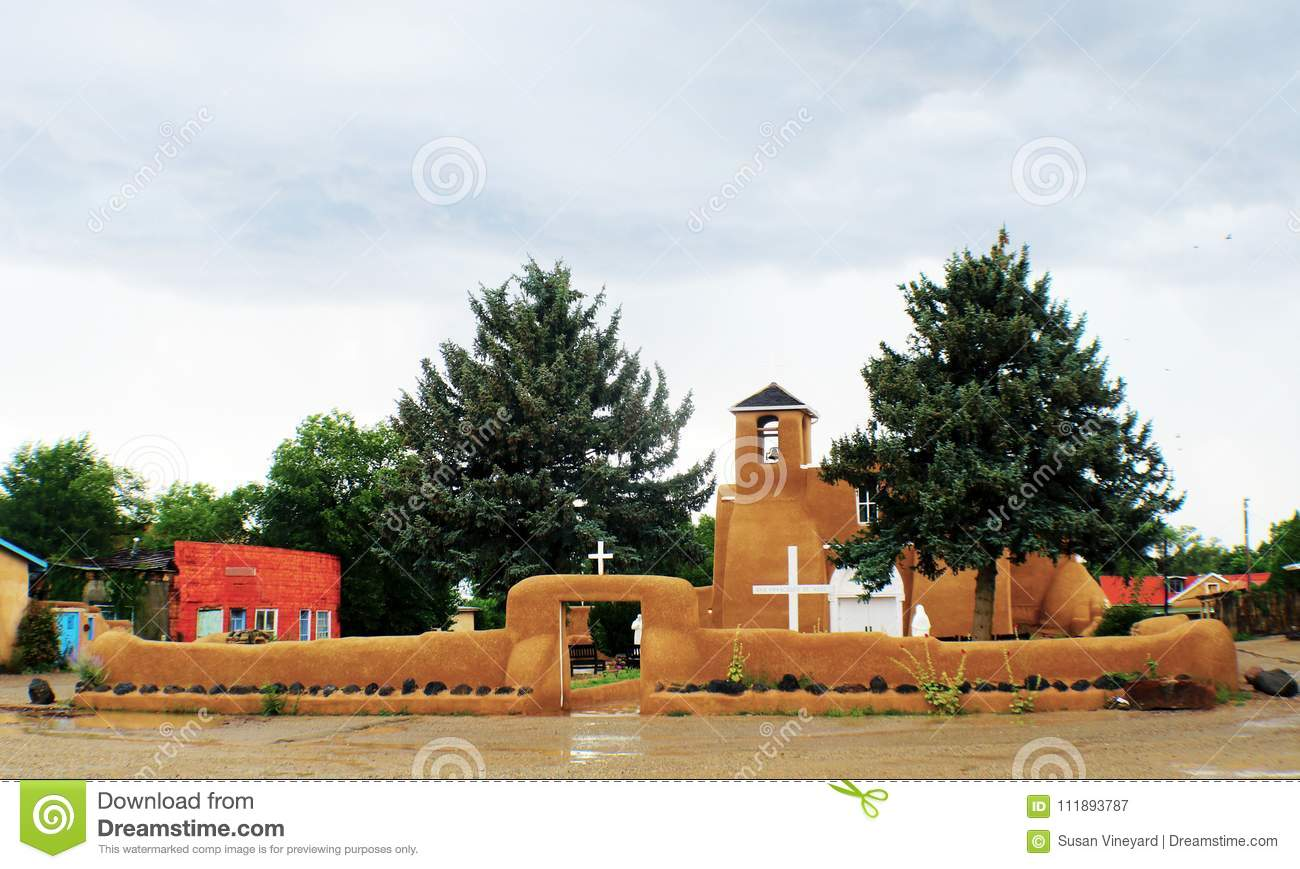 San Francisco de Asis Mission Church in Taos New Mexico on a rainy day