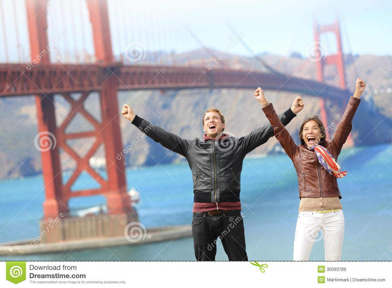 San Francisco happy people tourist couple at Golden Gate Bridge. Young ...