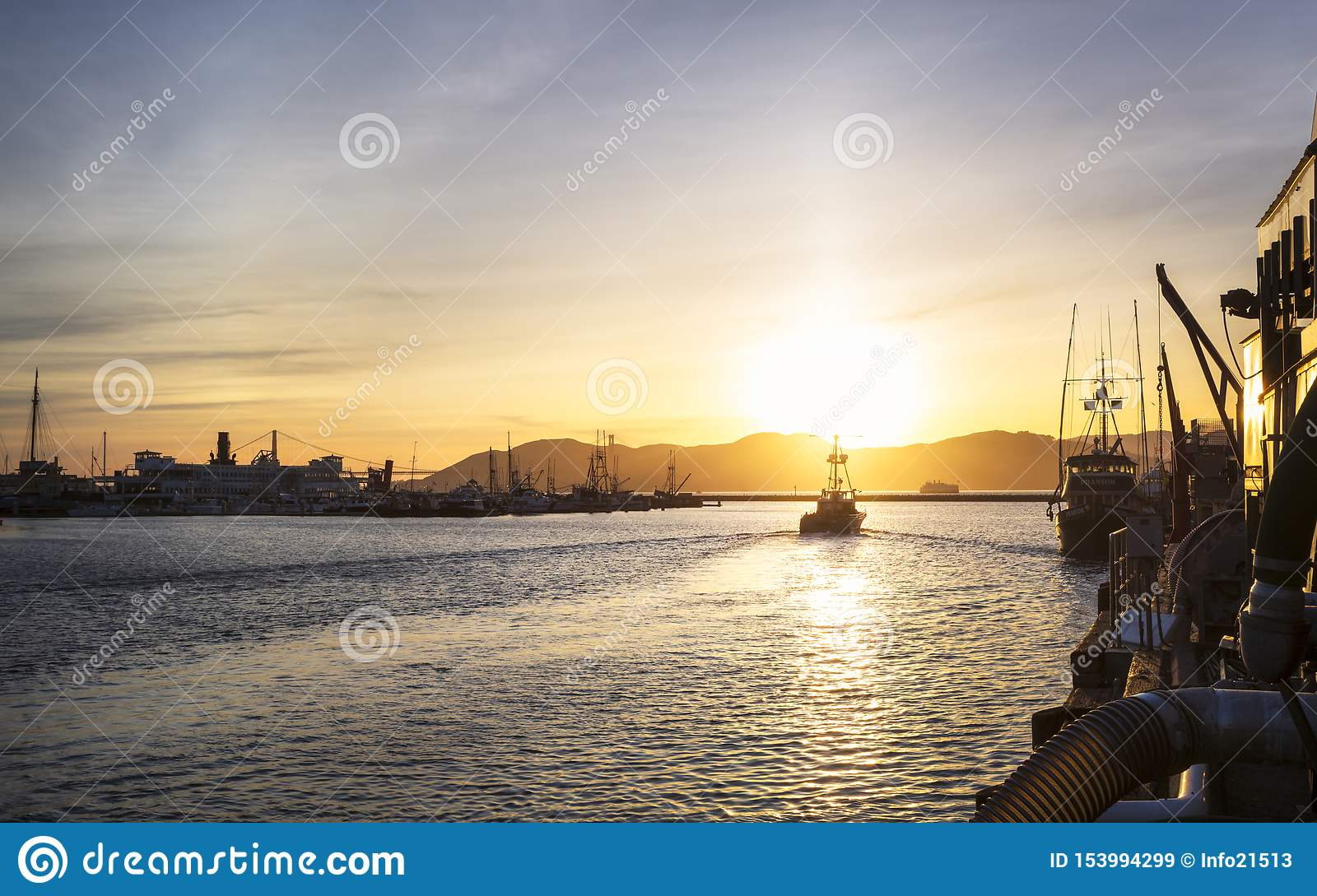 View of Golden Gate Bridge from Fishermans Wharf at sunset, San Francisco, California, United States of America, North