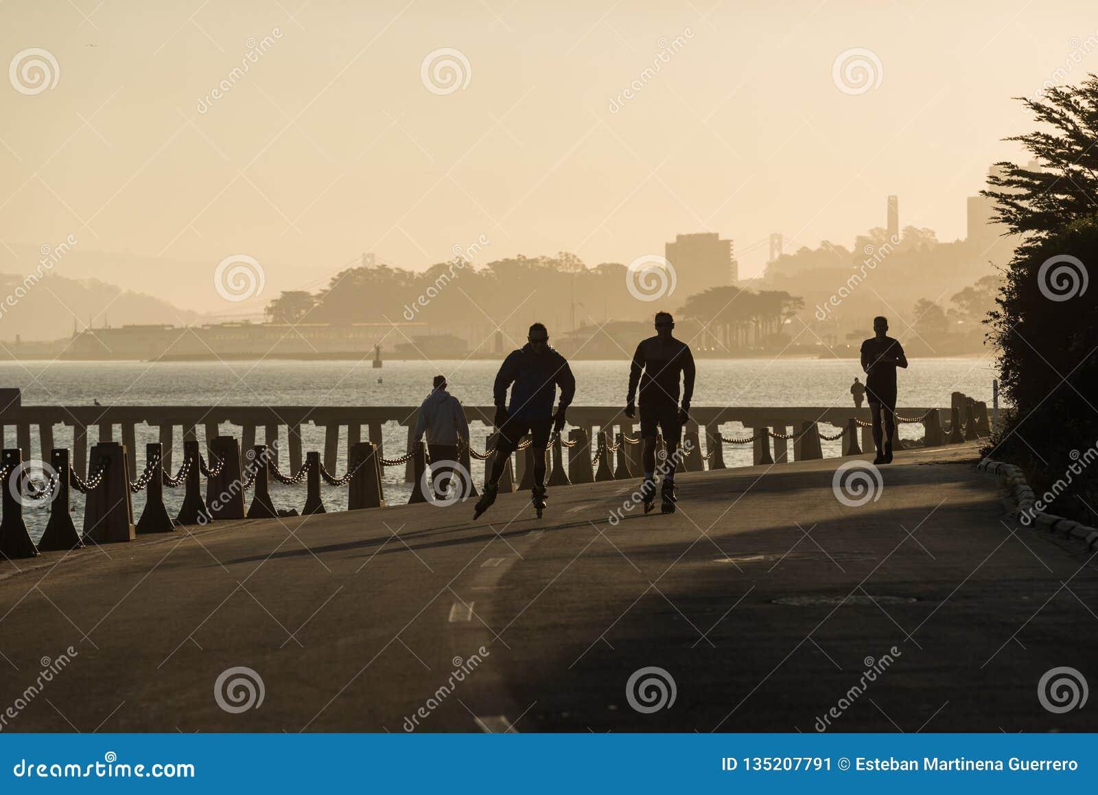 SAN FRANCISCO, USA - OCTOBER 12, 2018: People skating and running near Torpedo Wharf and Fort Point San Francisco