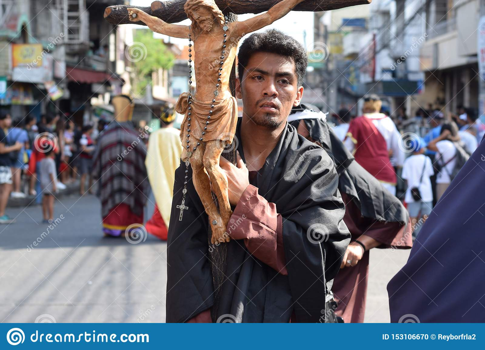 Huge crucifix carried by holy man, street drama, community celebrates Good Friday representing the events that led to the Crucifix