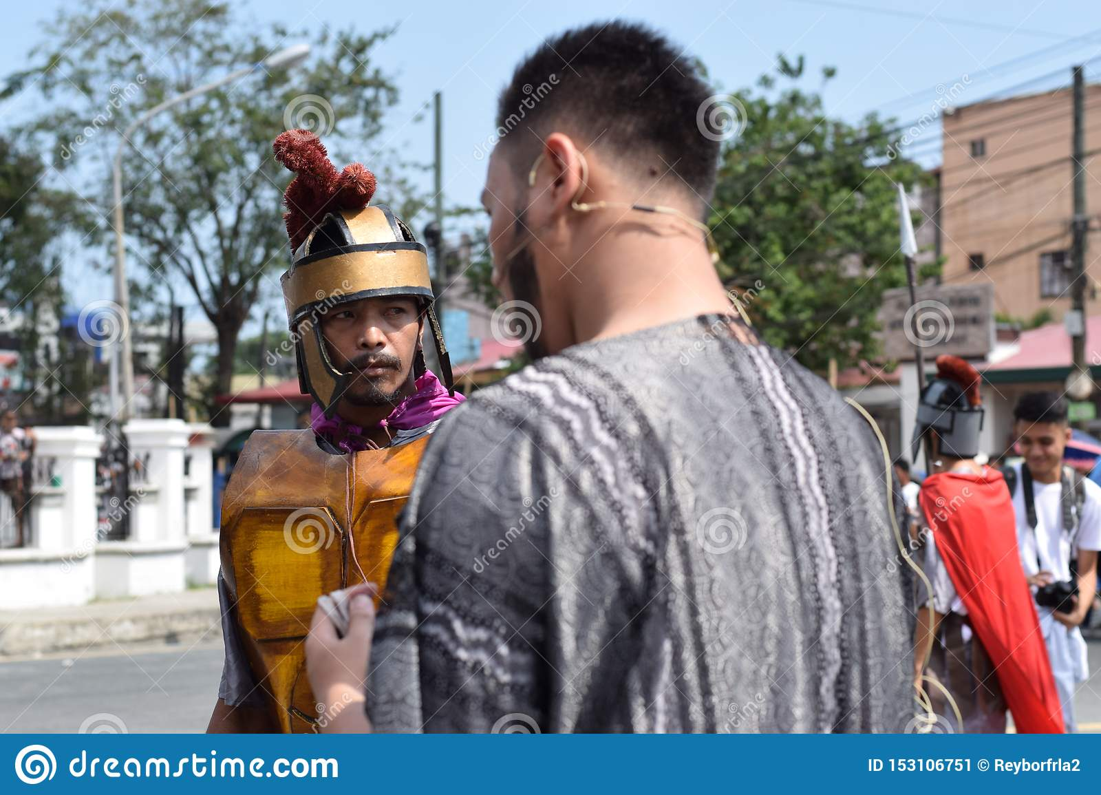Judas iscariot confronted by rude roman soldier, street drama, community celebrates Good Friday representing the events that led t