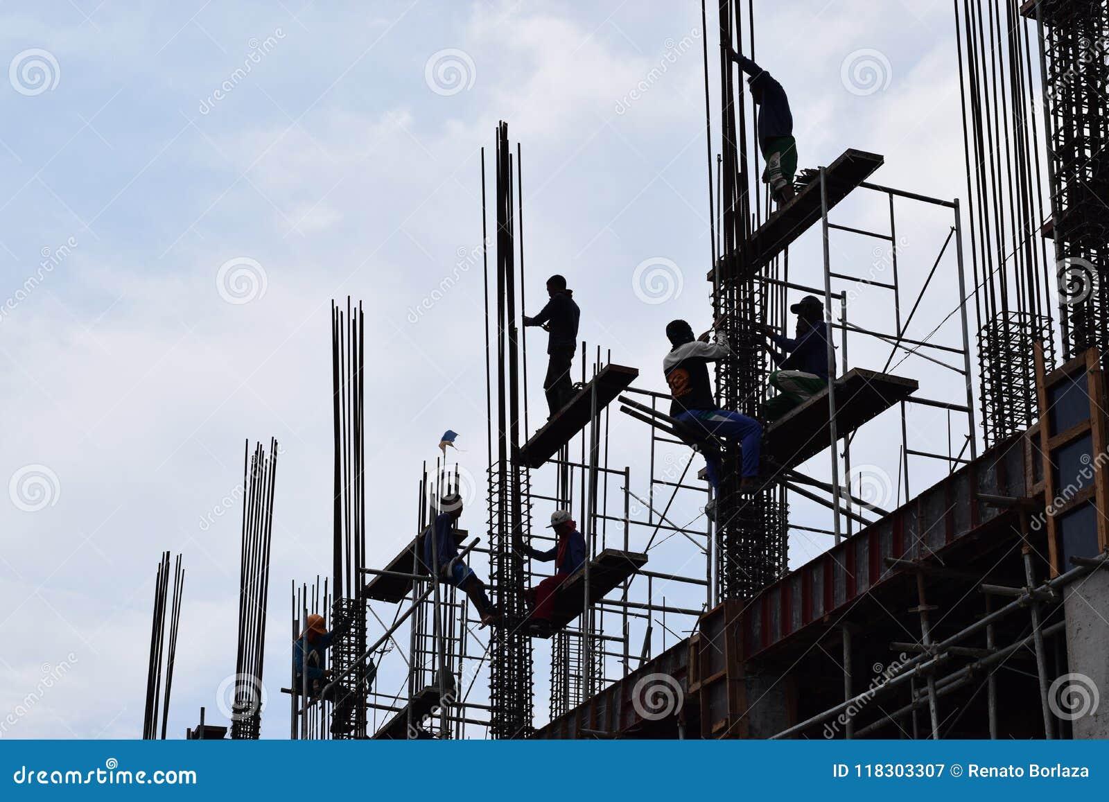 Filipino Construction Steel-men Working Joining Column Steel Pieces