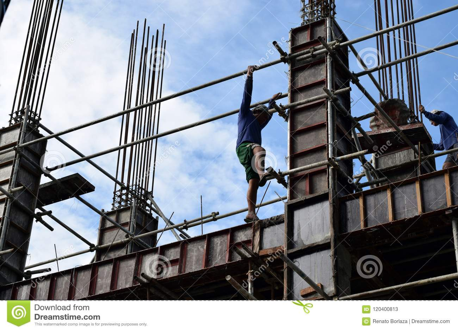 Filipino Construction Steel-man Climbing Down Using Scaffolding