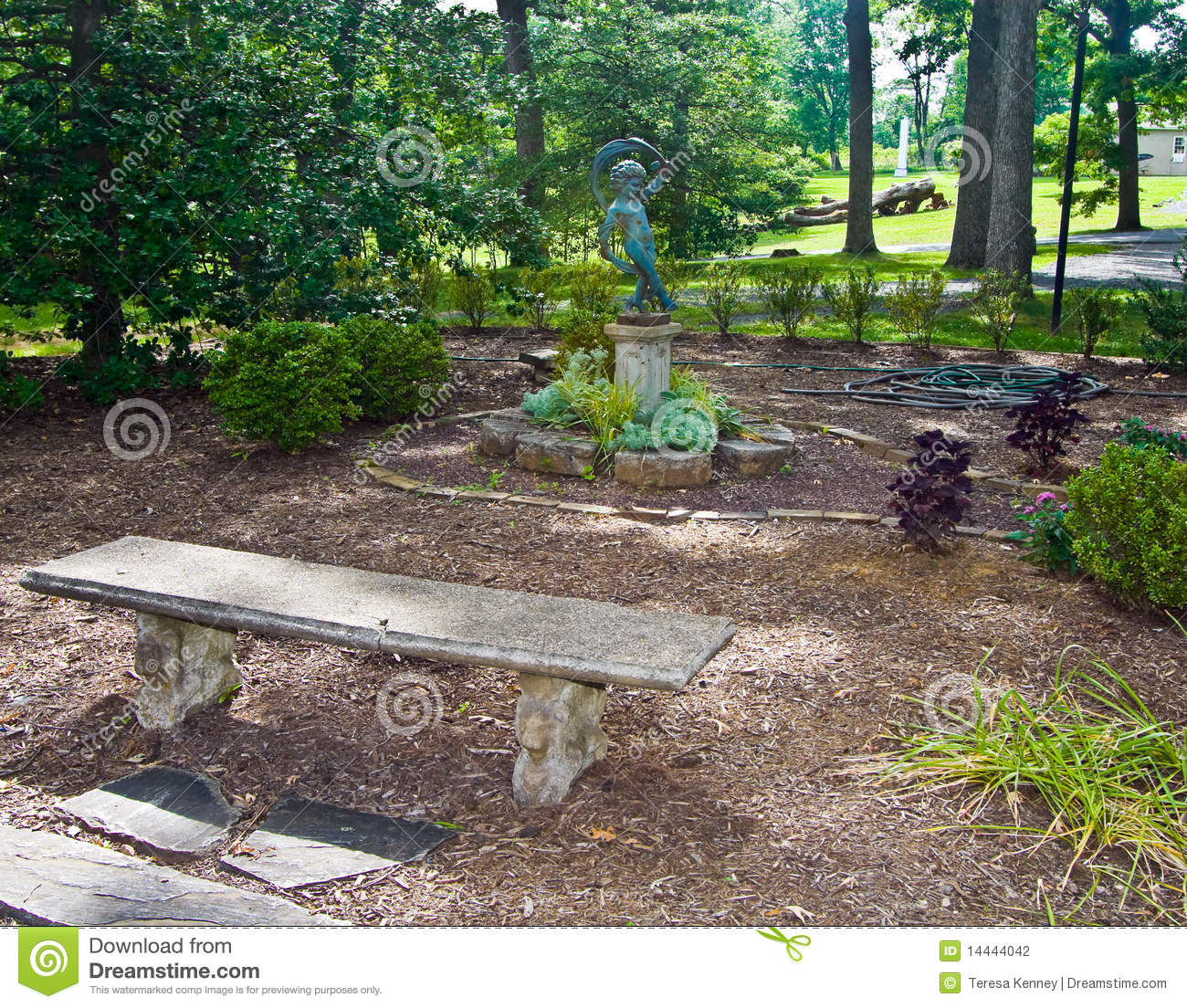 formal gardens with cherbu statue stone bench and stone accents