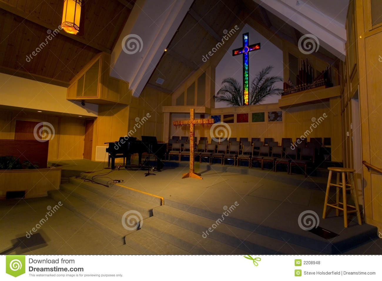 Sanctuary With A Stained Glass Cross