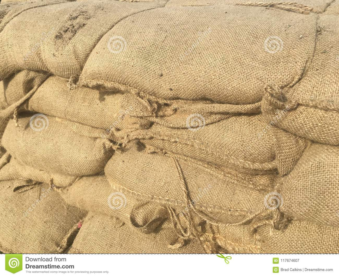 Sand bags forming wall