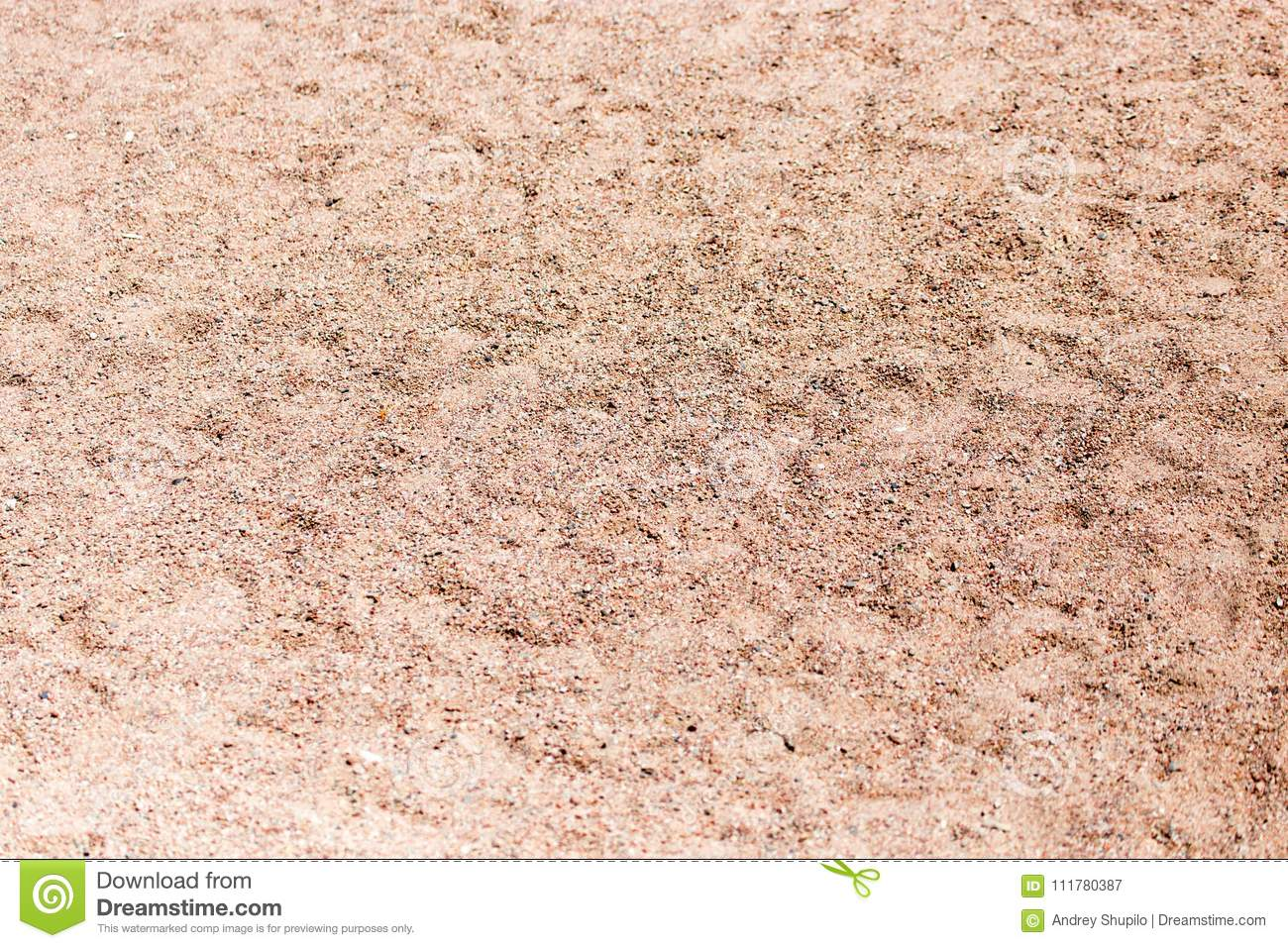 The sand on the beach as background