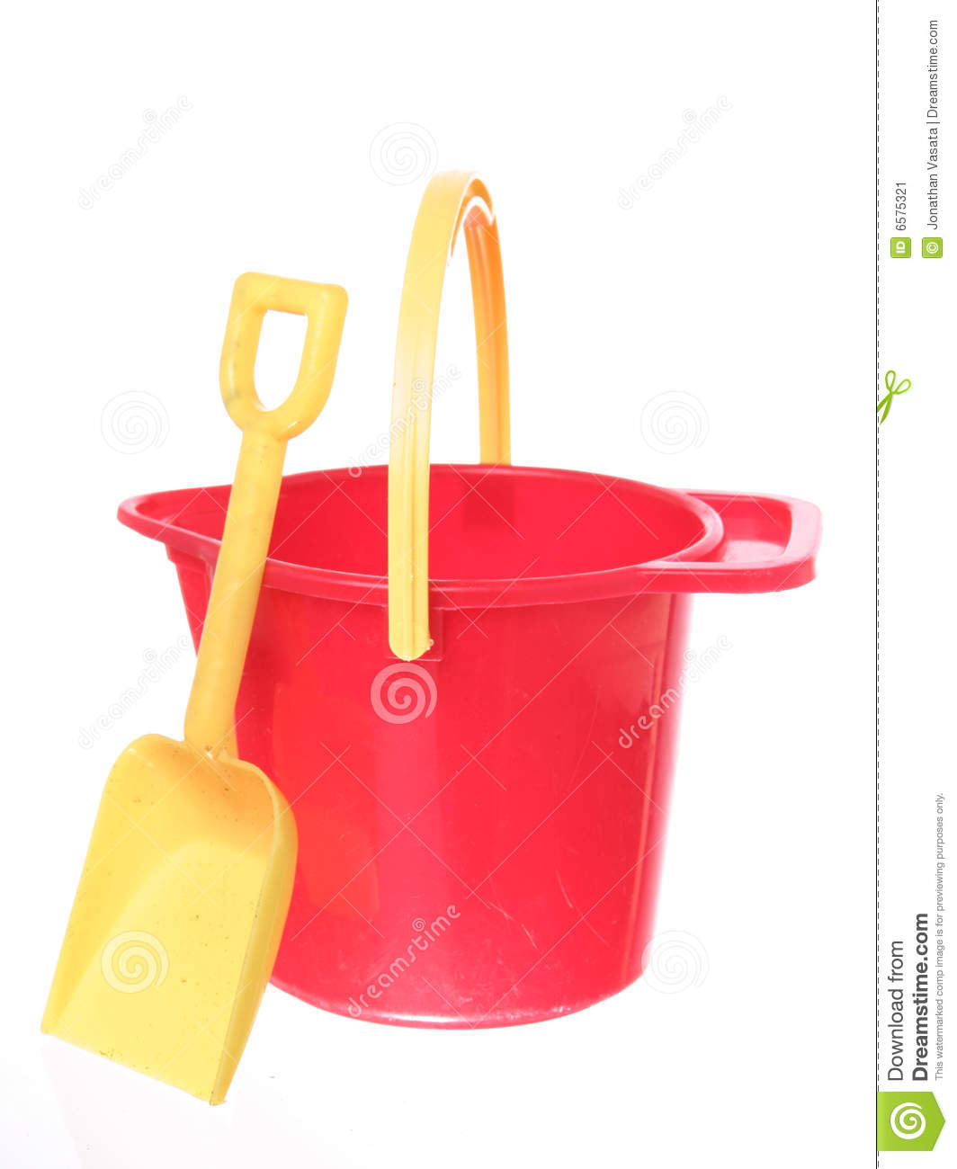 Yellow handle up on red sand bucket with yellow shovel, isolated on