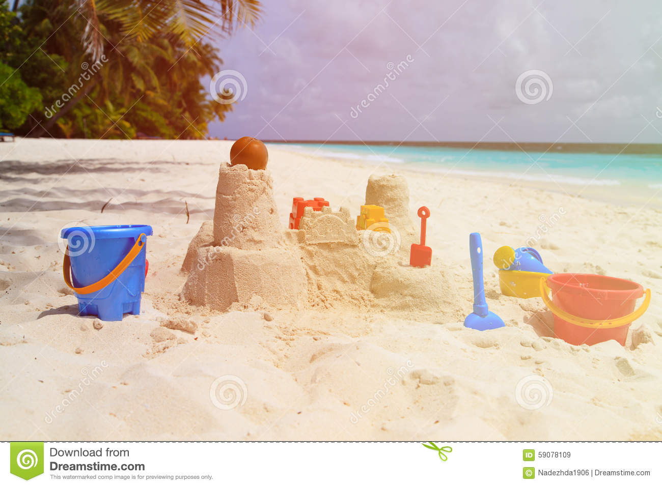 Sand Castle On Beach And Kids Toys Stock Photo - Image ...
