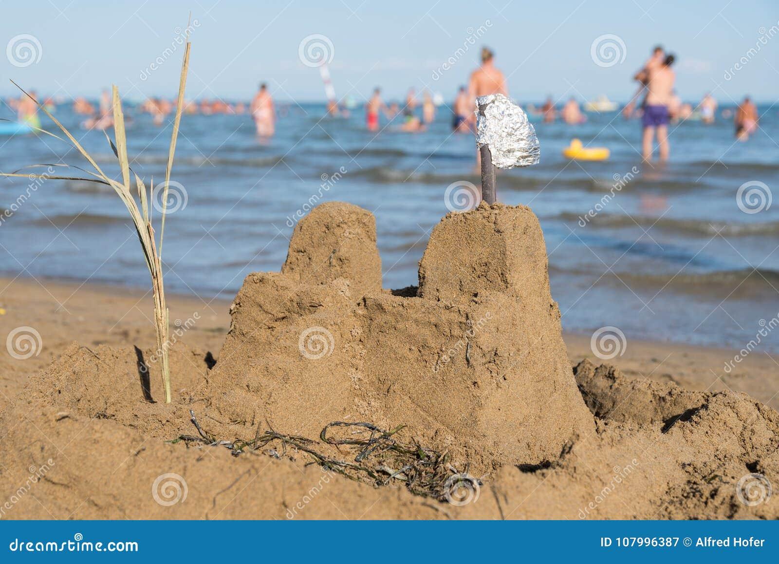 Sandcastle overlooking sea
