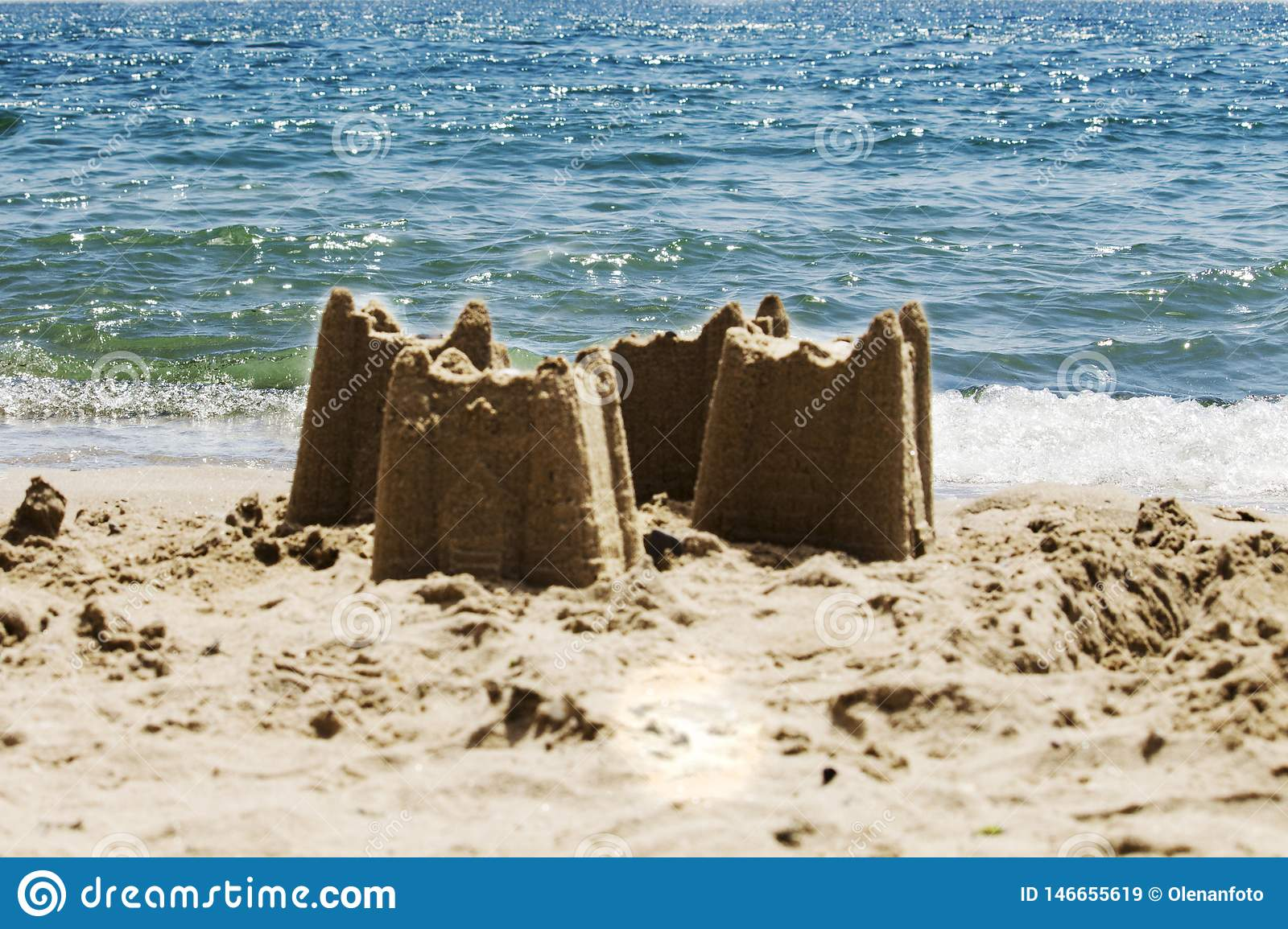 Sand castles on the beach with the sea in the background, s