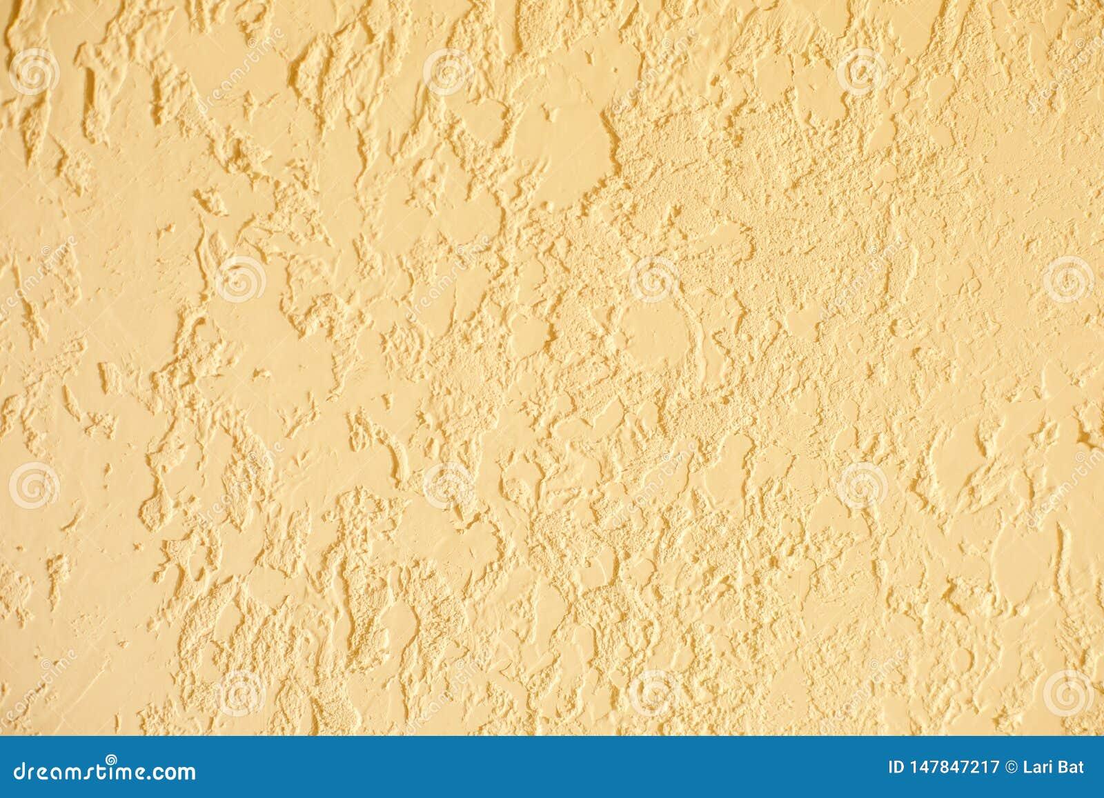 Sand color textured plastered wall. Fresh otvetka in commercial premises, designer renovation in the house