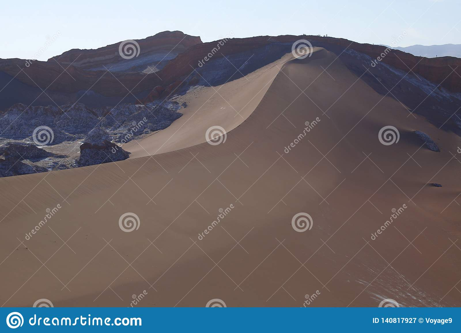 Valle de la Luna - Valley of the Moon and snow-covered volcanoes, Atacama Desert, Chile