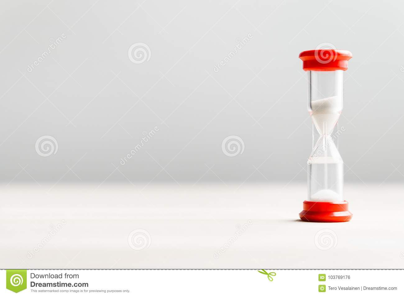 Sand in hourglass. Time passing concept.