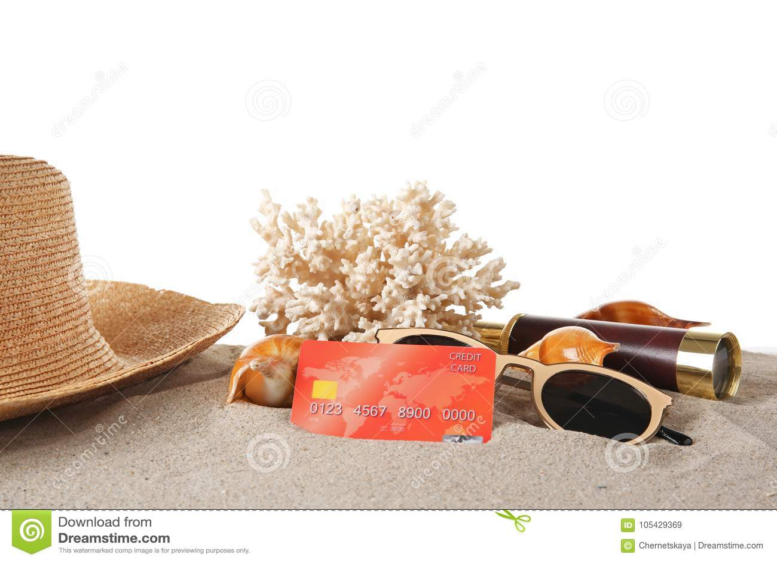 Sand med kreditkorten och korall