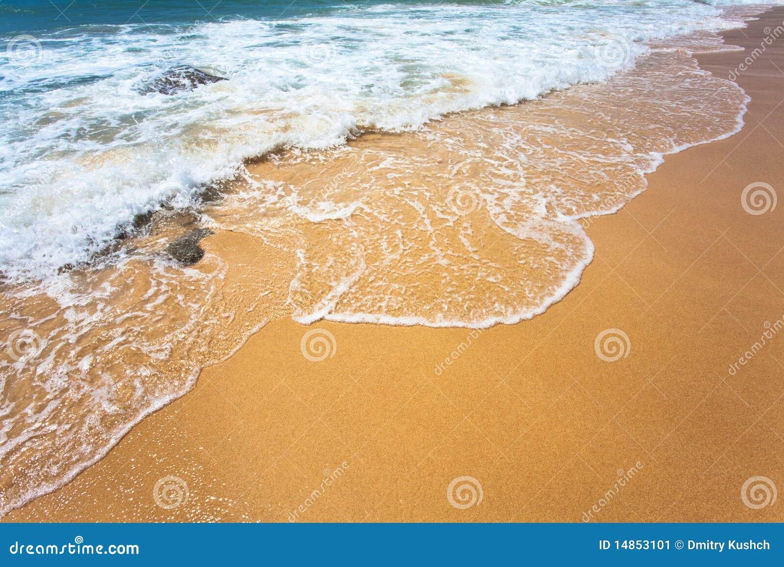 Sand and sea wave