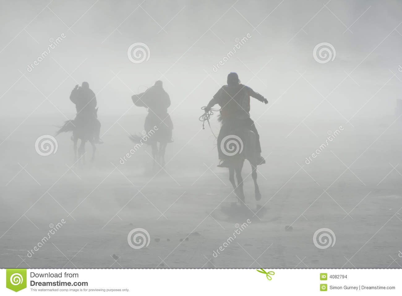 Sand storm horse riders mount bromo