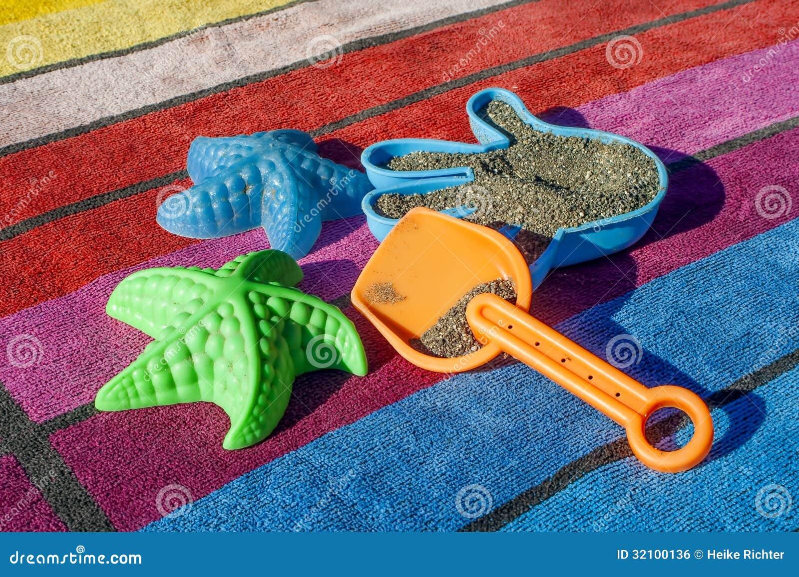 Beach Towel Clip Art Colorful plastic beach toys on