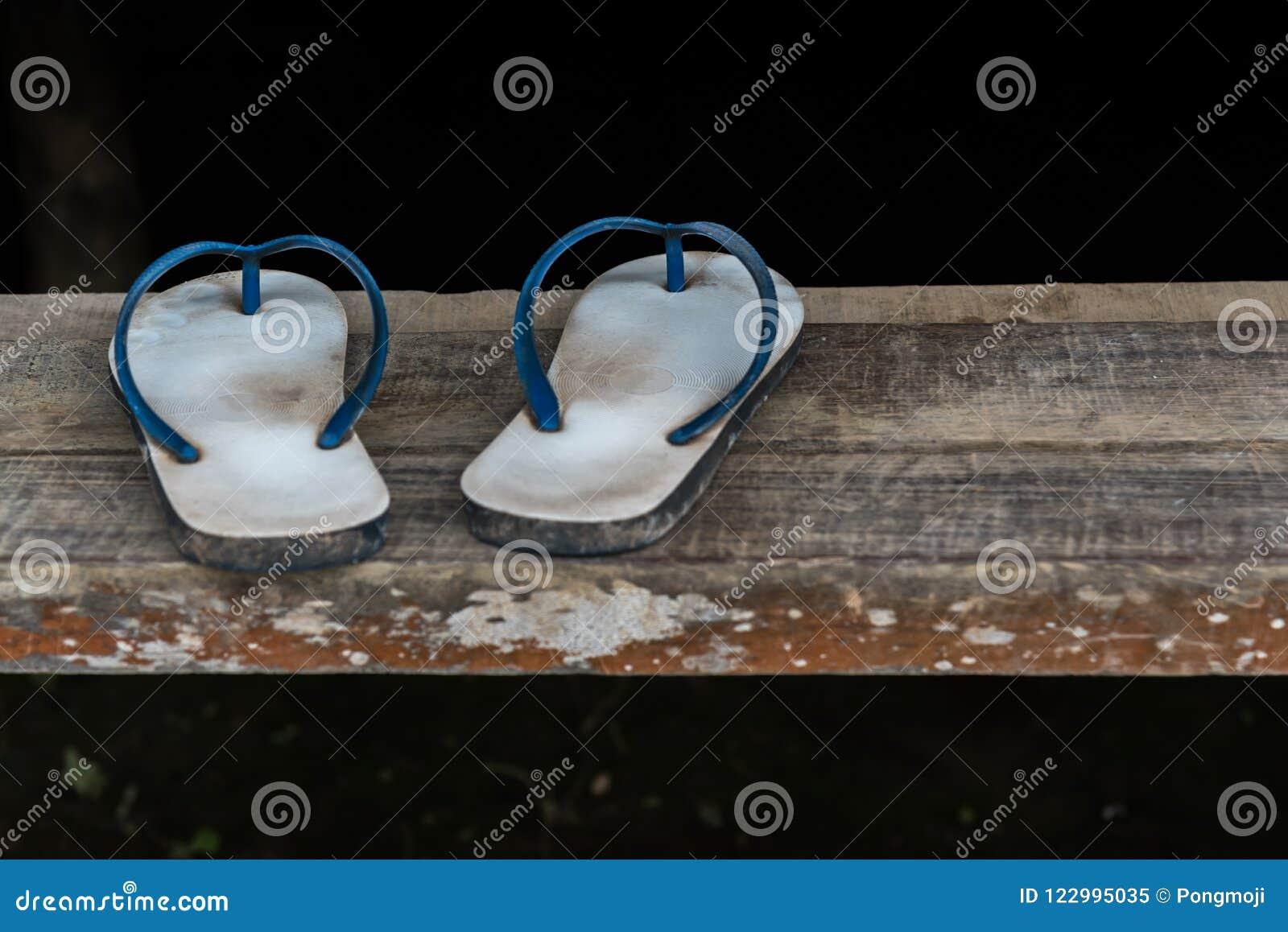 0614c2234 Vintage sandal or thongs or flip-flop blue color is a footwear on wooden  staircase or floor