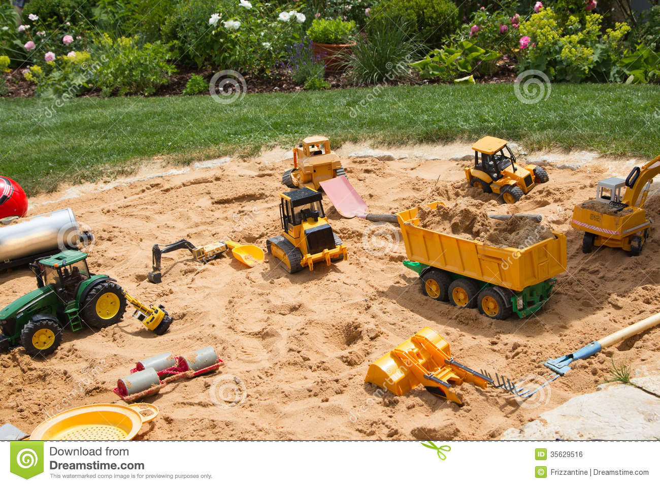 Sandpit In A Garden With Different Sand Play Things