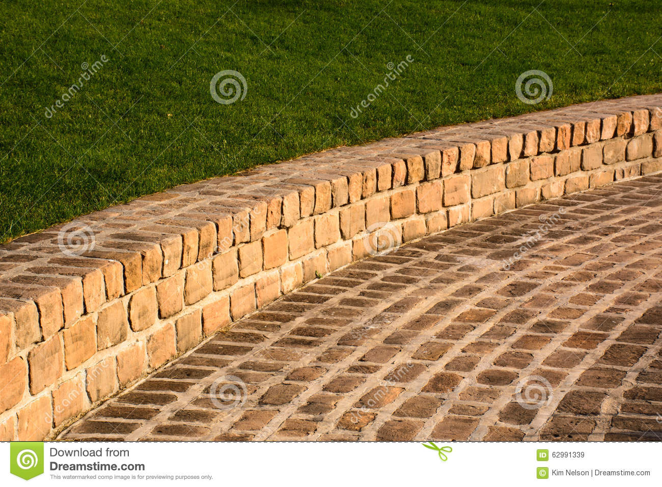 Sandstone Brick Walkway And Grassy Hill As A Background
