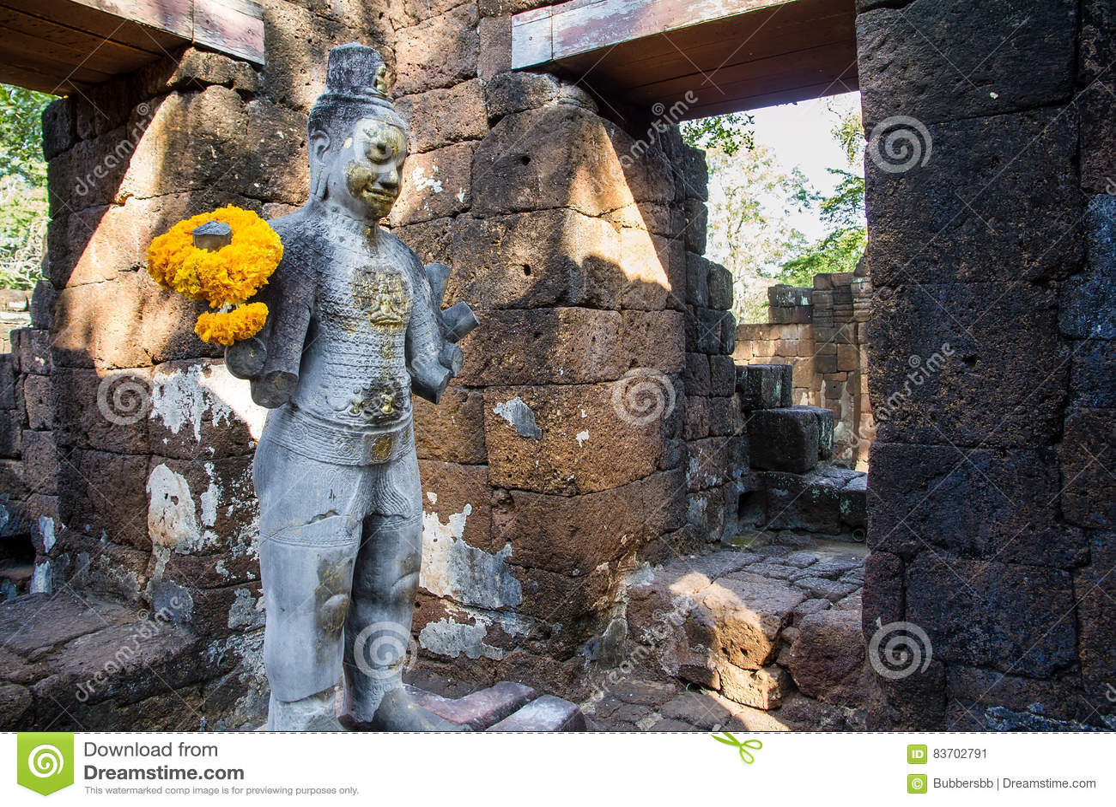 Sandstone Statue Of God Khmer Art At Ancient Thai Castle Or Pras Stock Photo