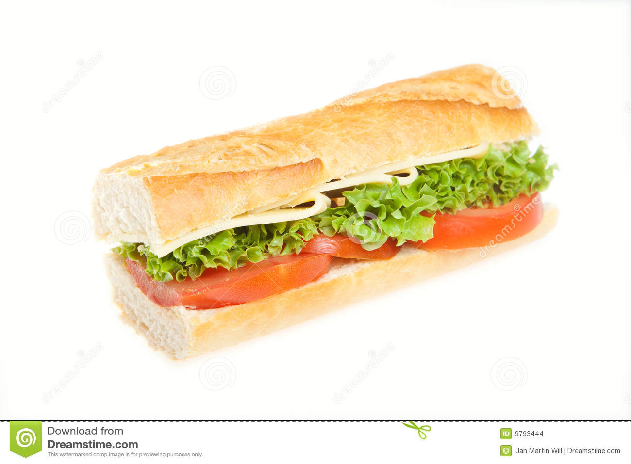 High angle view of cheese, lettuce and tomatoes in sliced baguette ...