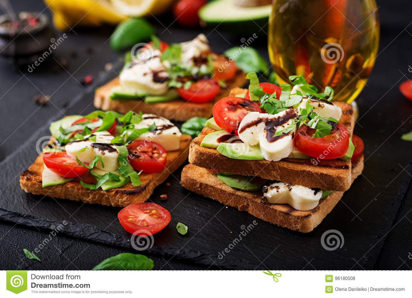 https://thumbs.dreamstime.com/z/sandwich-toasts-tomatoes-mozzarella-avocado-basil-balsamic-vinegar-96180508.jpg