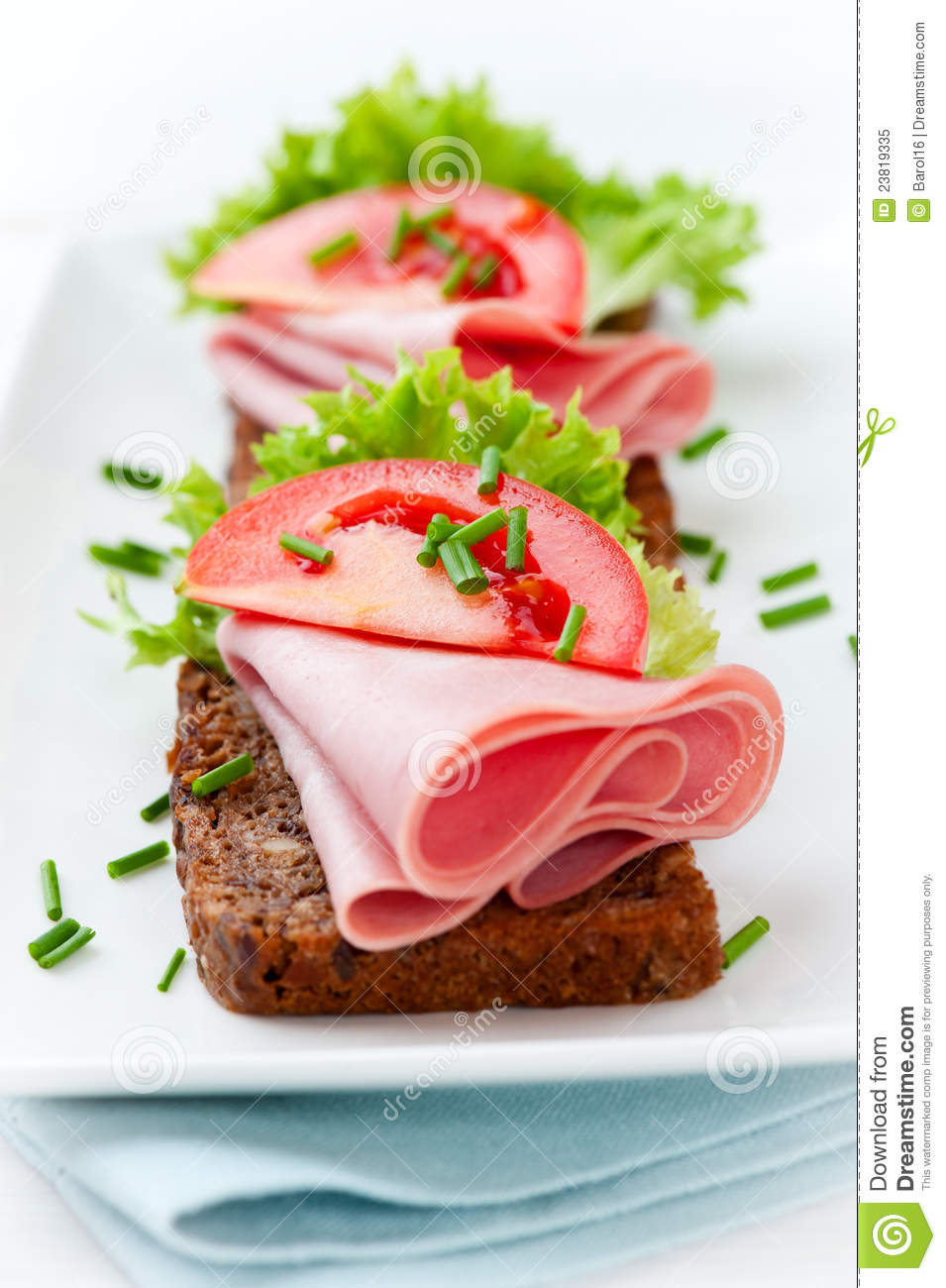 Sandwiches with ham and fresh vegetables
