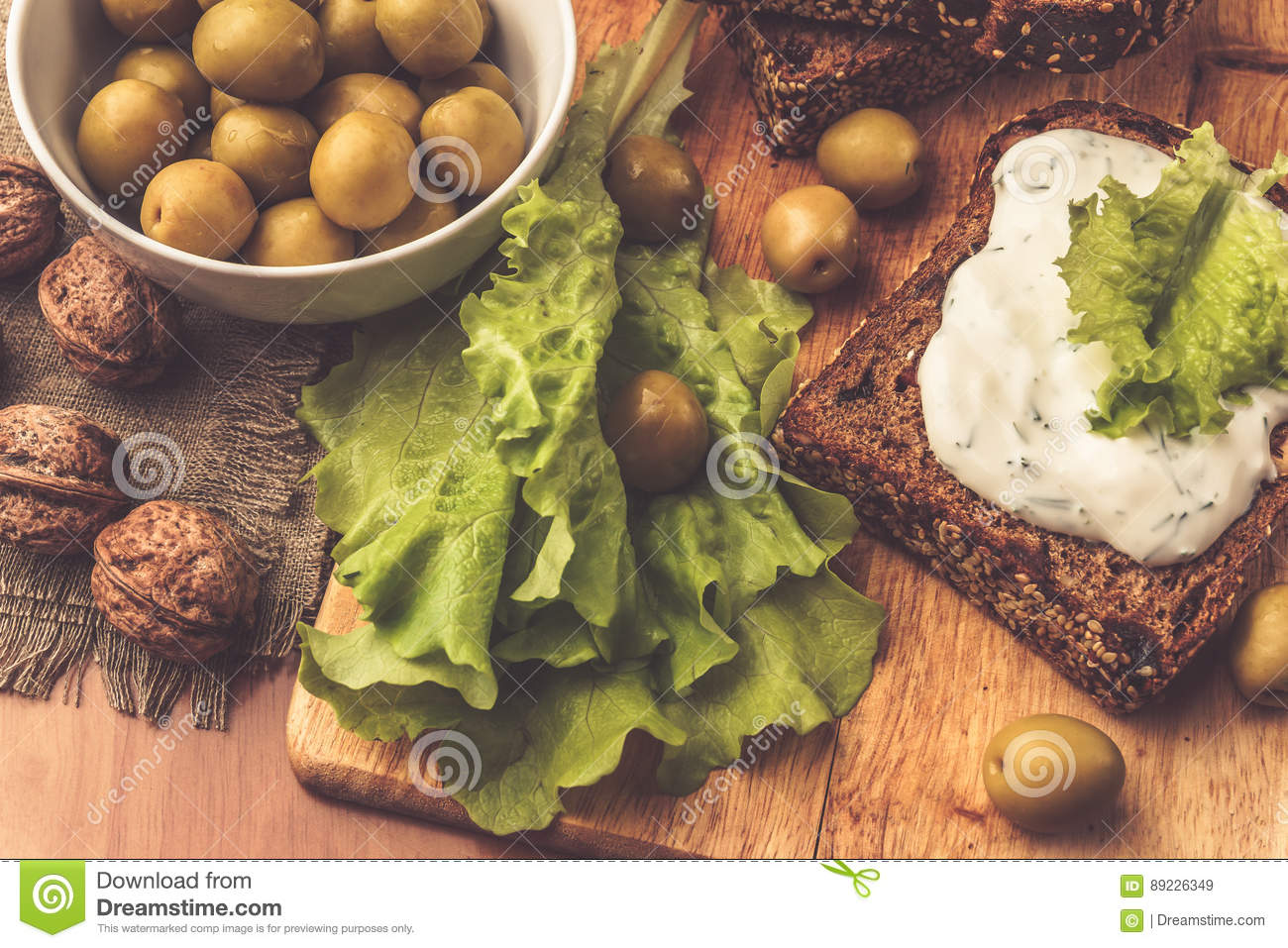 Sandwiches of homemade bread with cheese sauce or cream, lettuce, walnuts, olive