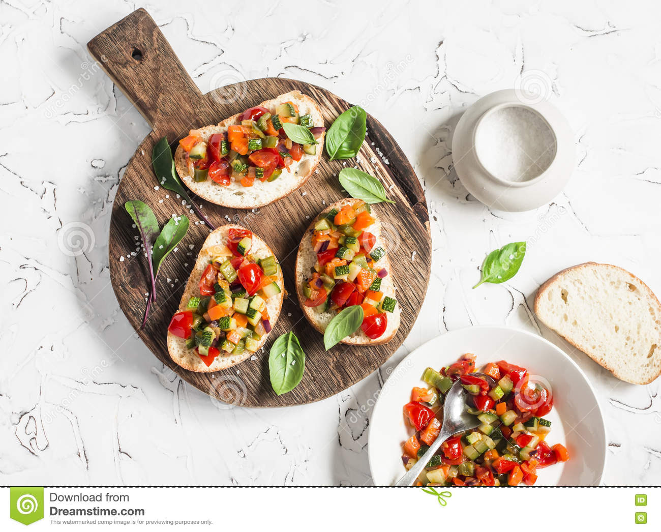 Sandwiches with quick ratatouille on rustic cutting board on a light background. Delicious healthy vegetarian food