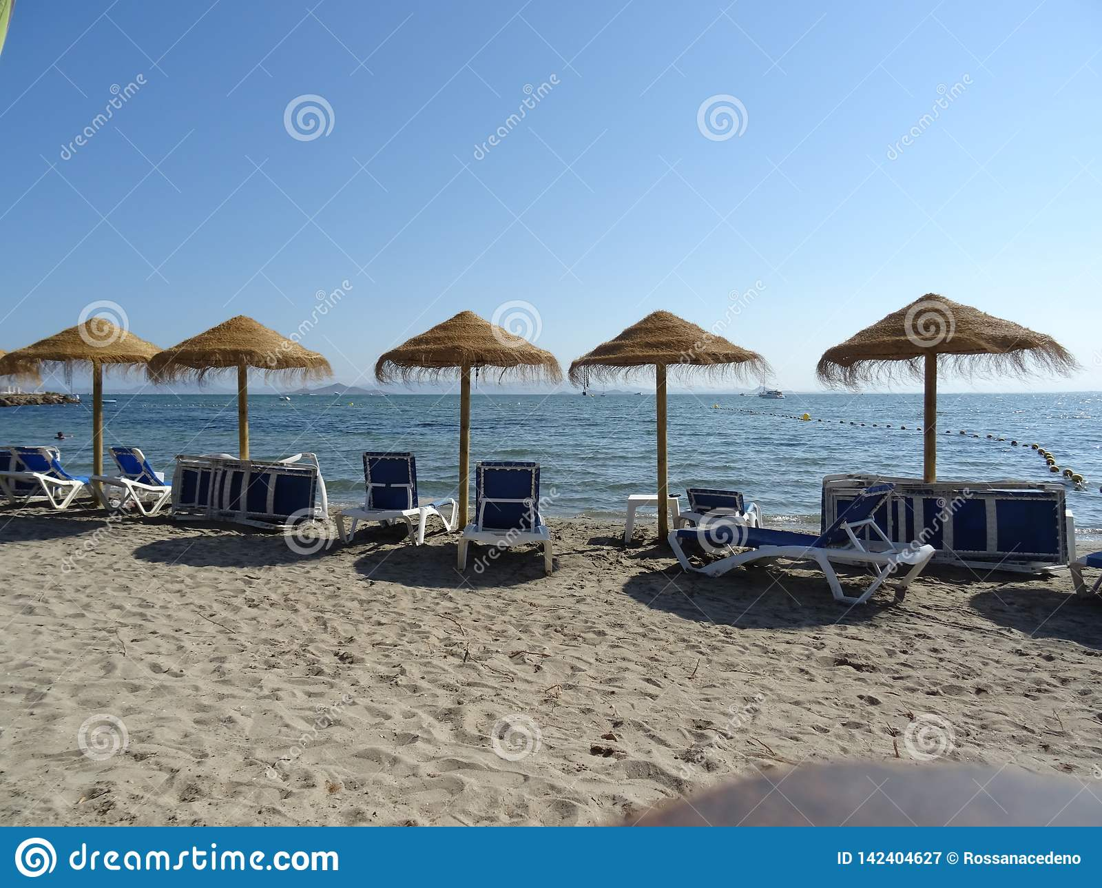 Sandy beach, chairs and umbrellas in La Manga, Spain