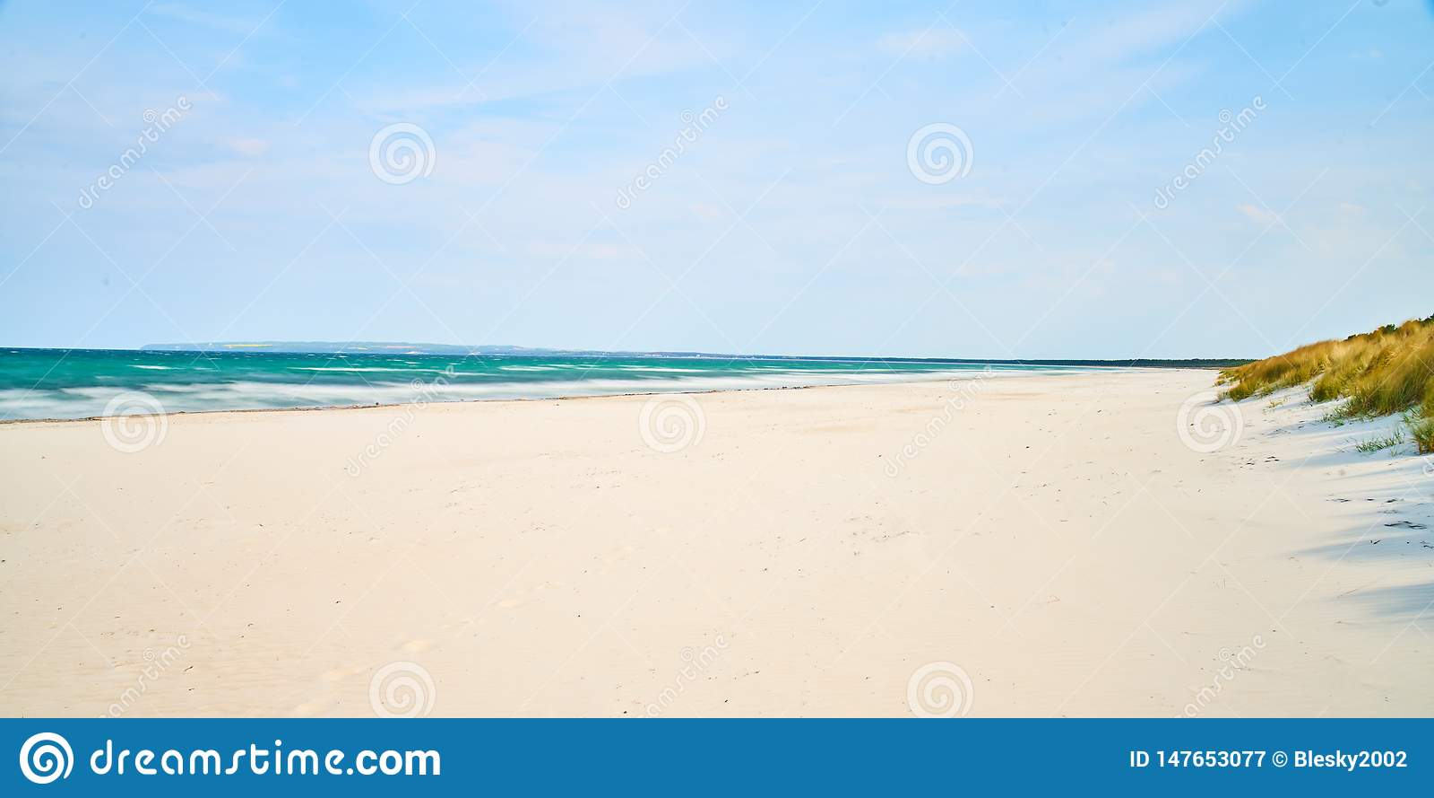 Sandy beach, white sand blue sky, Germany