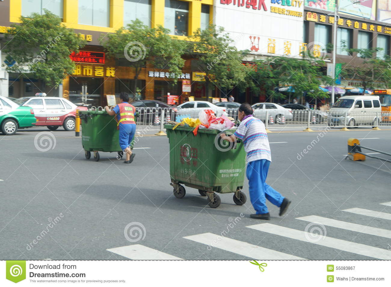 The sanitation workers push the rubbish bin through the road editorial photography image 55083867 - Rd rubbish bin ...
