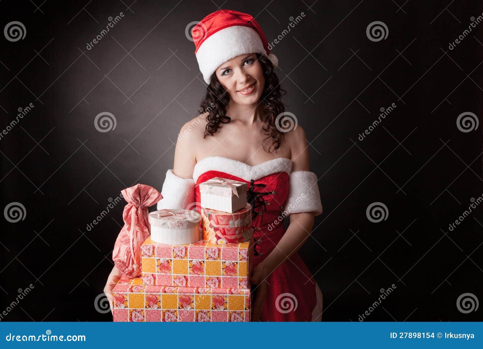 Sankt-Mädchen Ist Holding Weihnachtsgeschenke. Stockfoto - Bild von ...