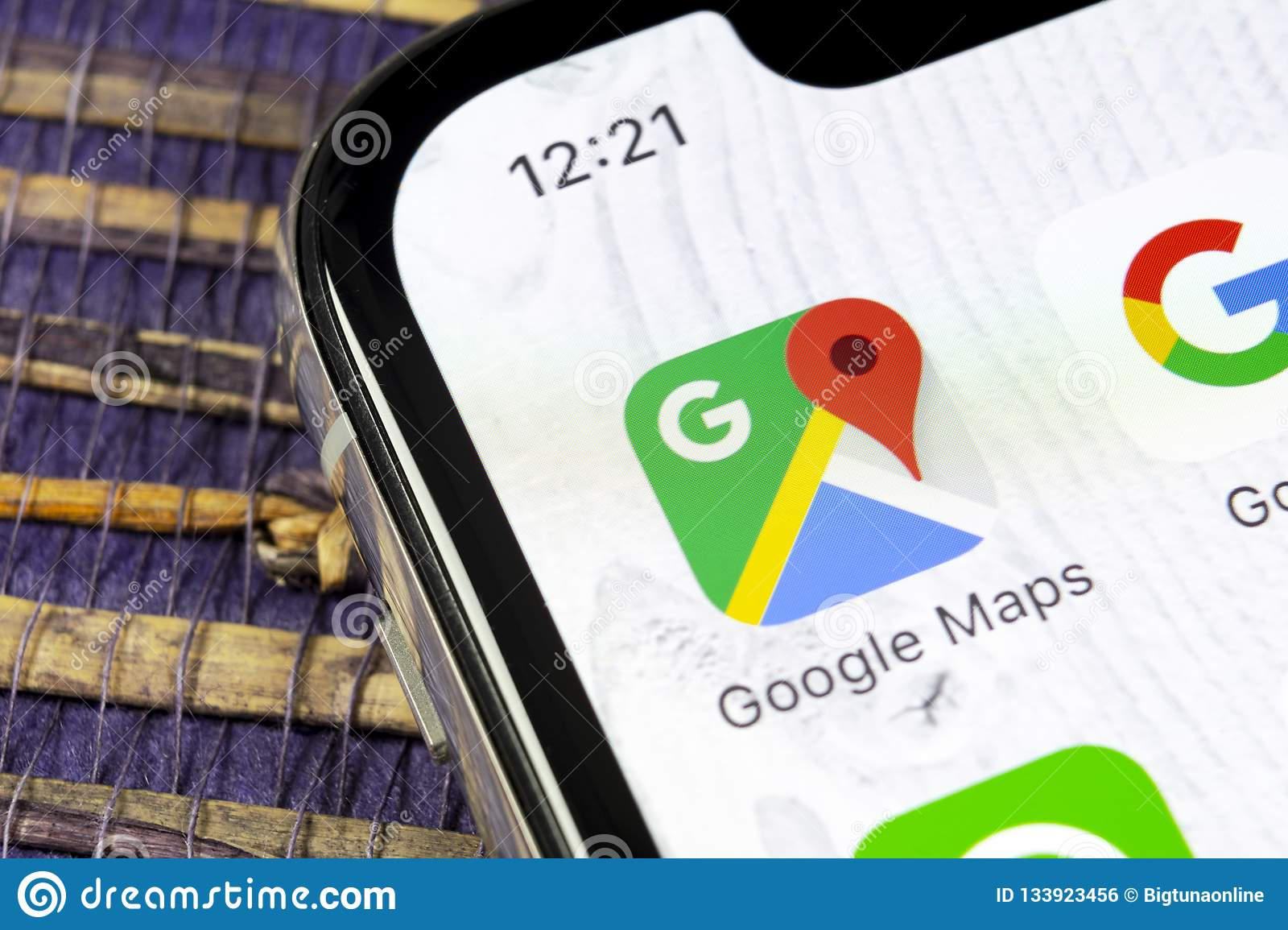 Google Maps application icon on Apple iPhone X screen close-up. Google Maps icon. Google maps application. Social media network