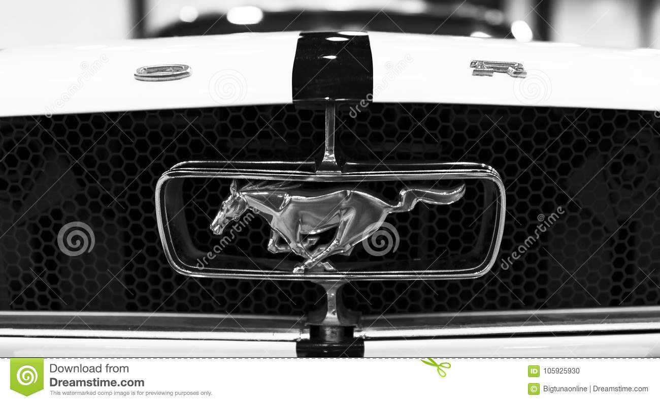 Front view of classic retro ford mustang gt logo with running horse car exterior details black and white